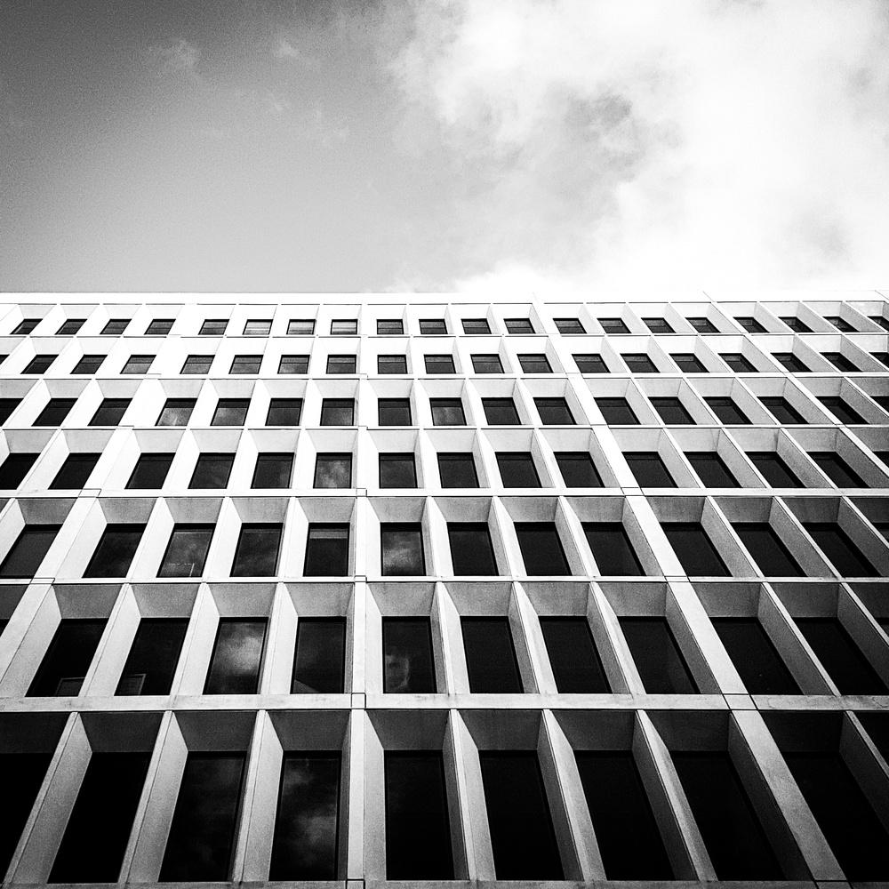Monochrome building  by Harrison Carr