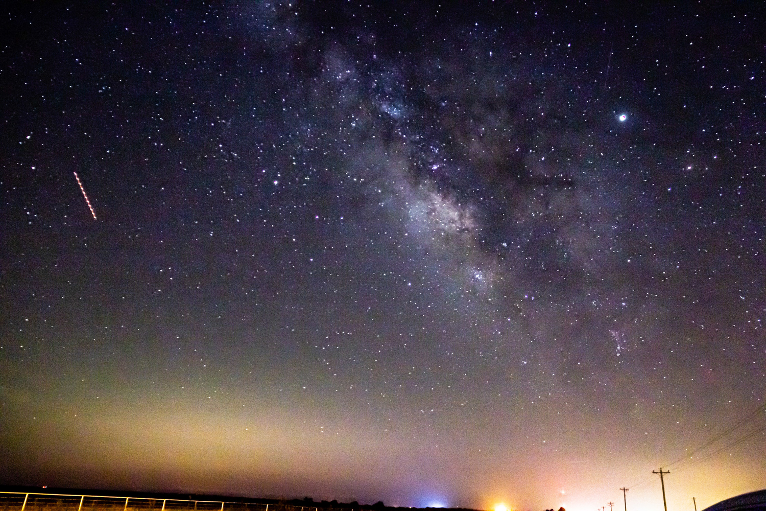 A plane traveling with the milkyway by Bobby Wood