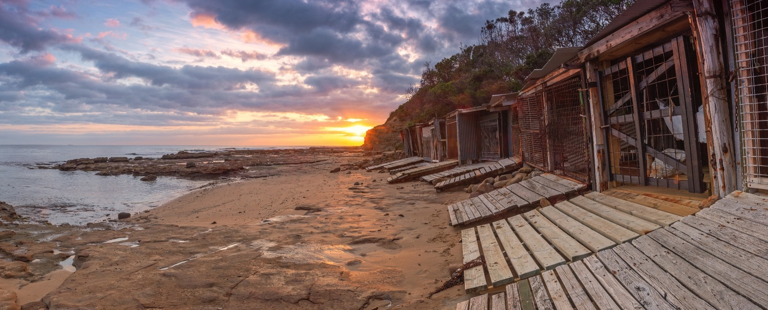 Sandon Point Boat Sheds at Sunrise by Shane Smith