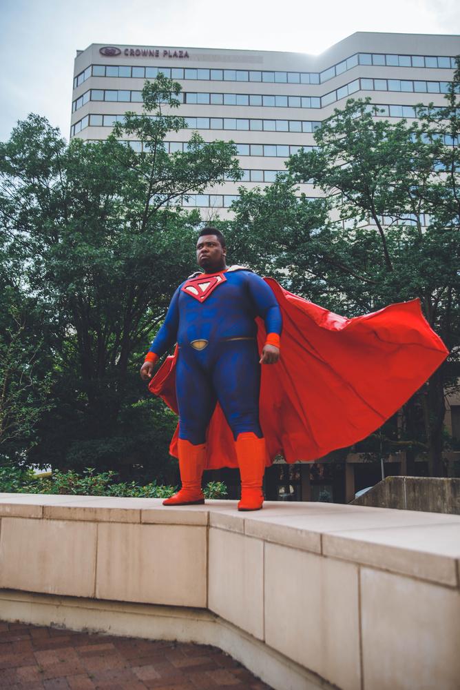 Superdude cape action by Christina Grande