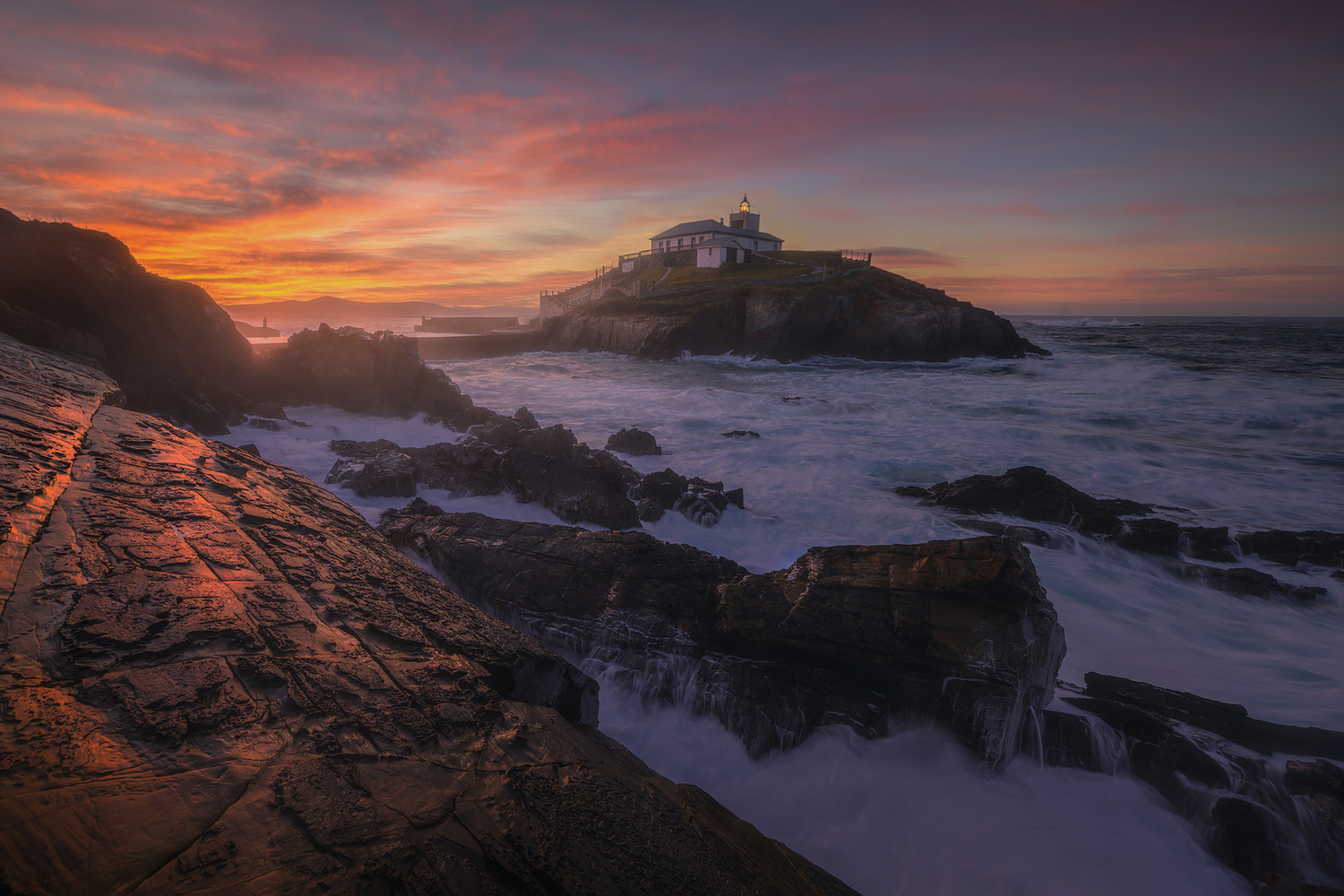 sunset in the lighthouse by alfonso maseda varela