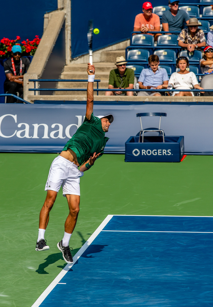 Novak punishes a tennis ball! :-) by David Pavlich