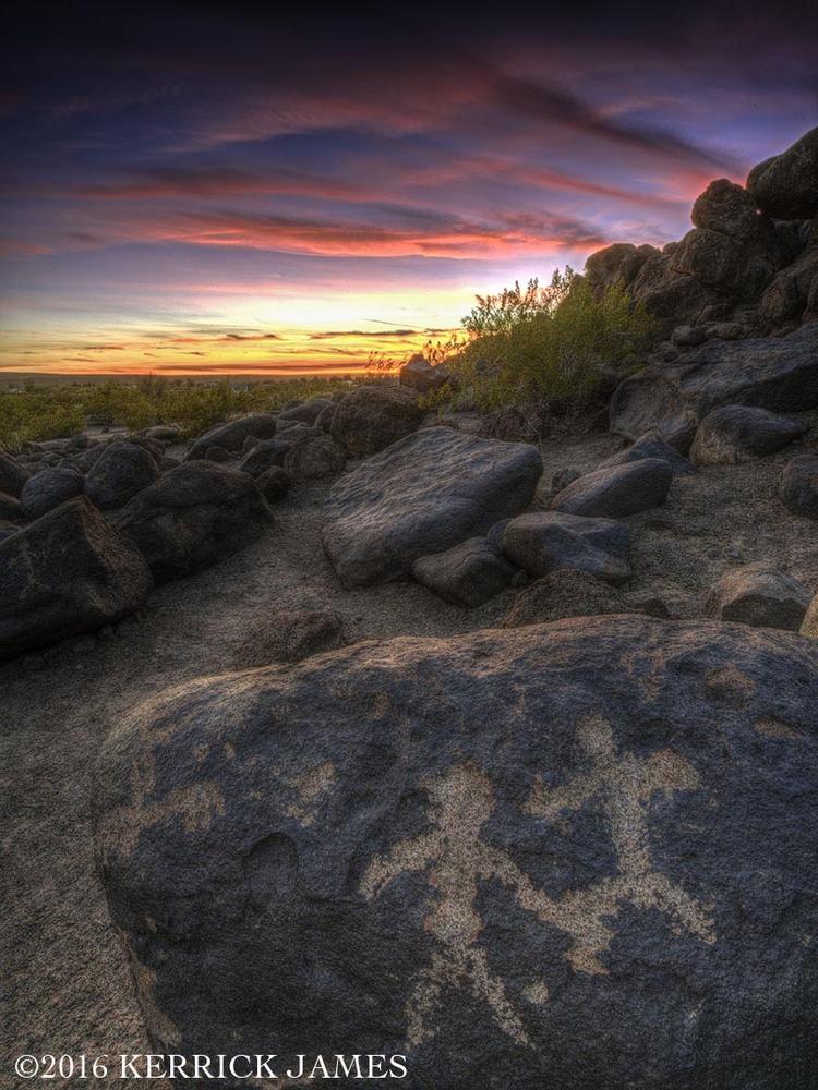 Petroglyph figures dance on boulders, Painted Rock Petroglyph Park, Arizona by Kerrick James