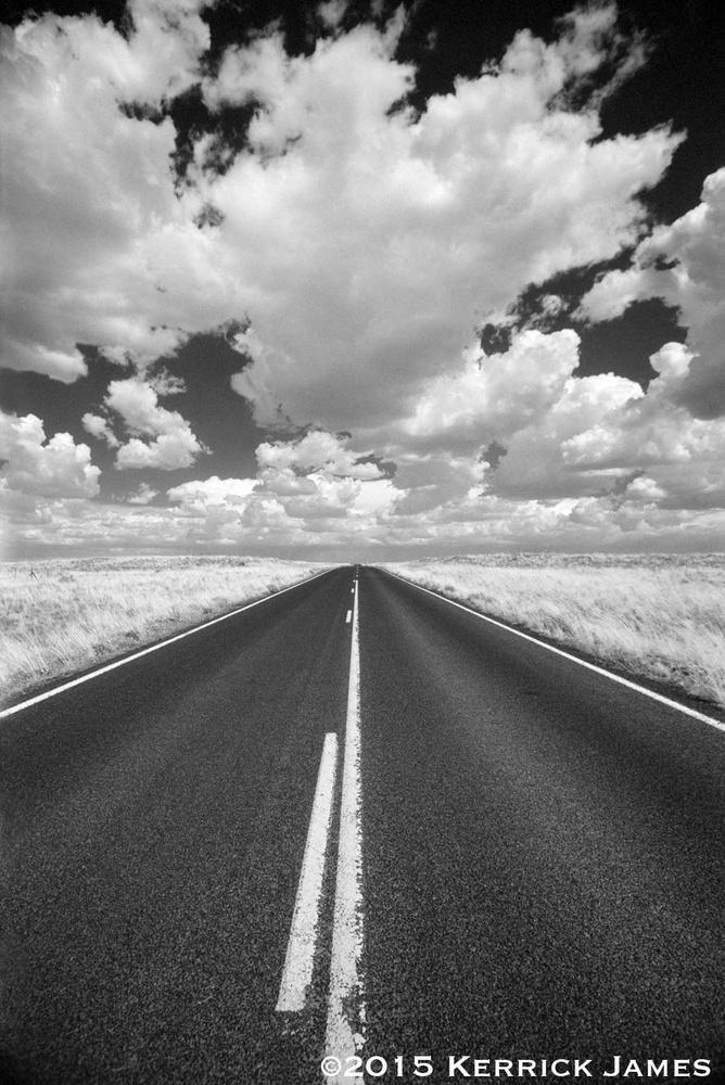 Rural highway, northern Arizona by Kerrick James