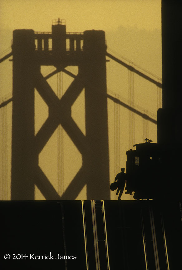 Man boarding the California Street cable car on Nob Hill, San Francisco, California by Kerrick James