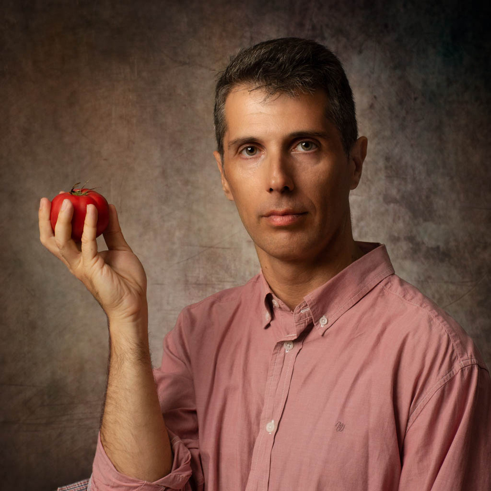 Carlos with a red apple by Xavier Caliz