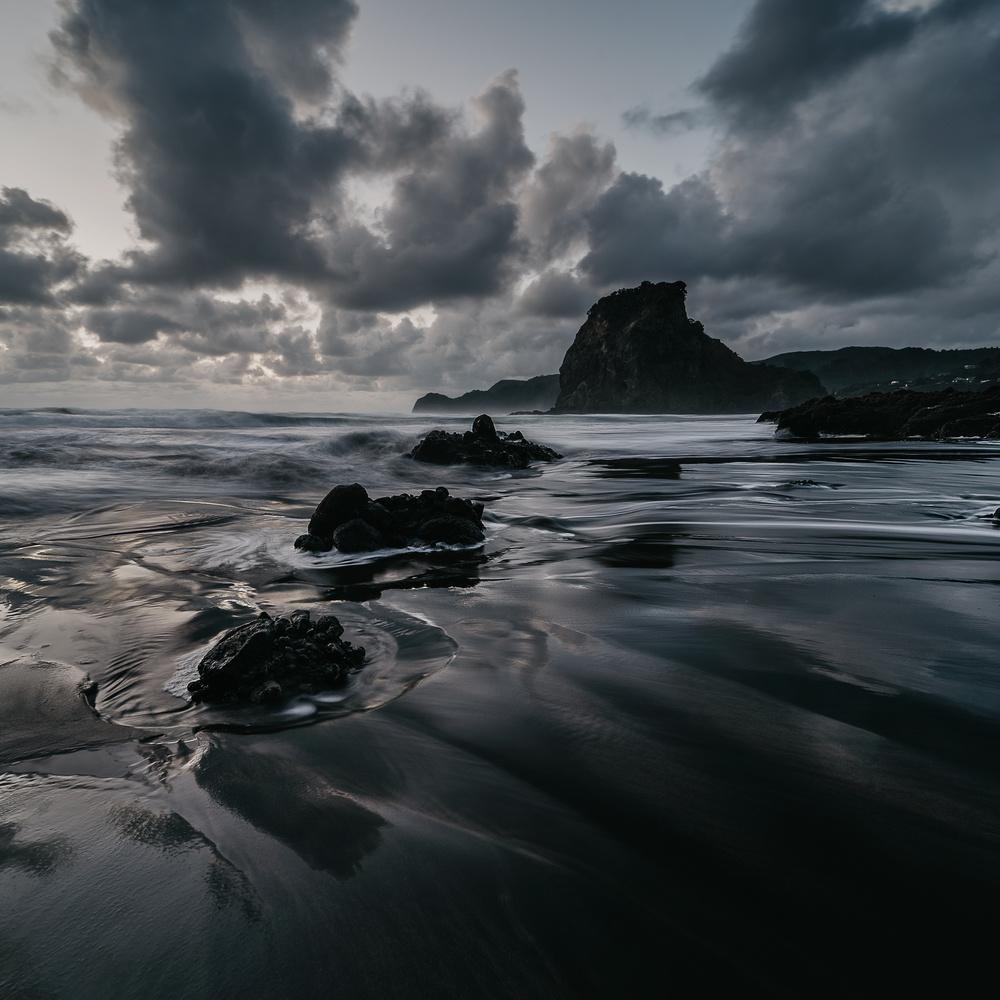 Moody scenes at Piha beach by Ryan Hill