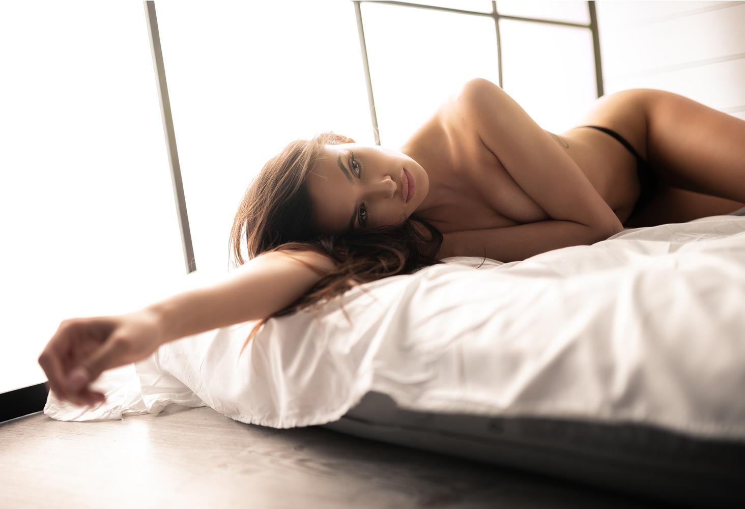 Sensual woman in studio by Krzysztof Budych