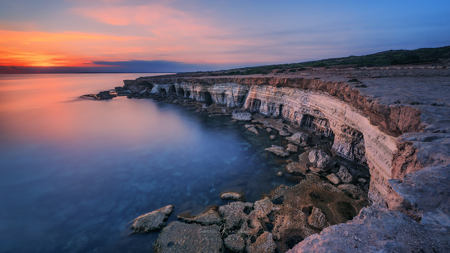 Calm and colorful Seacaves at Cape Greco by Christos Kaouranis
