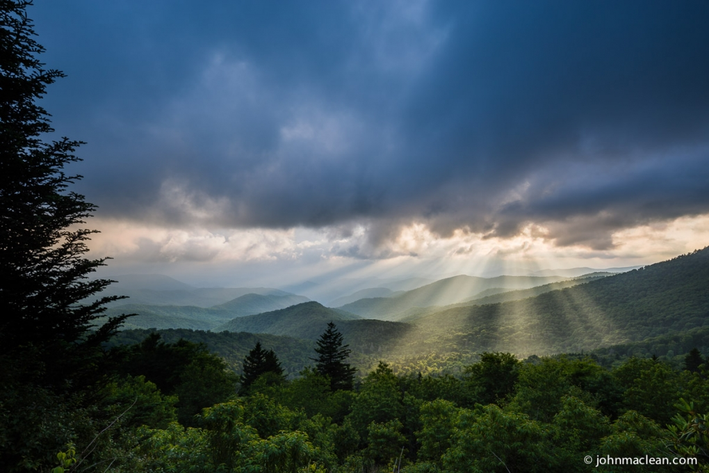 Crepuscular Rays on the Blue Ridge Parkway near Caney Fork Overlook, NC  by John MacLean