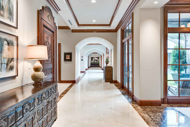 A beautiful long hallway of a Houston Million Dollar home by Vladimir Ambia