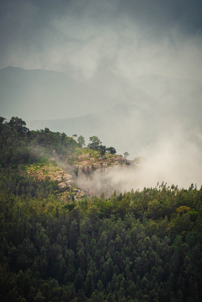 Misty clouds over valley by Madhan GC
