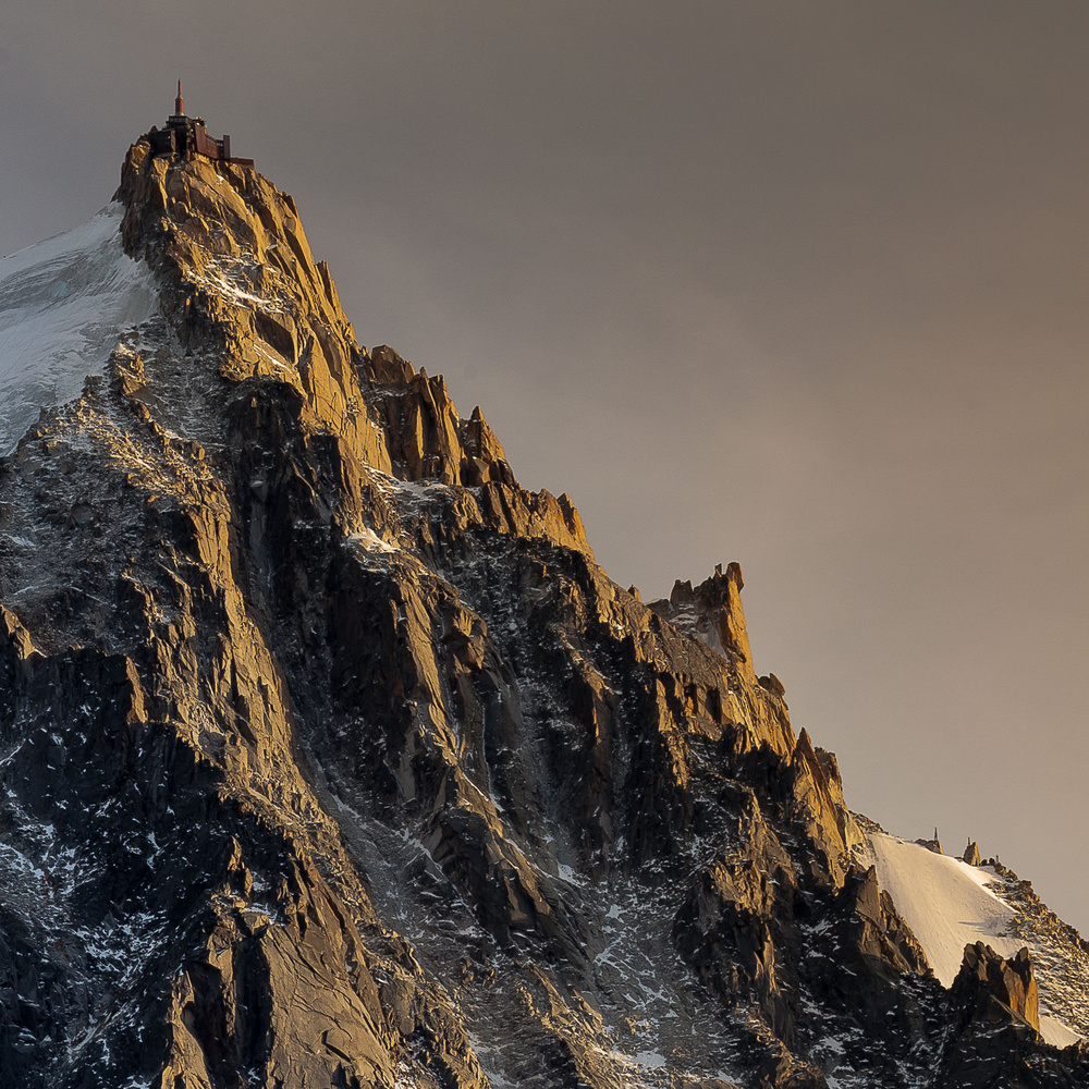 Aiguille du Midi at sunset by david huguet