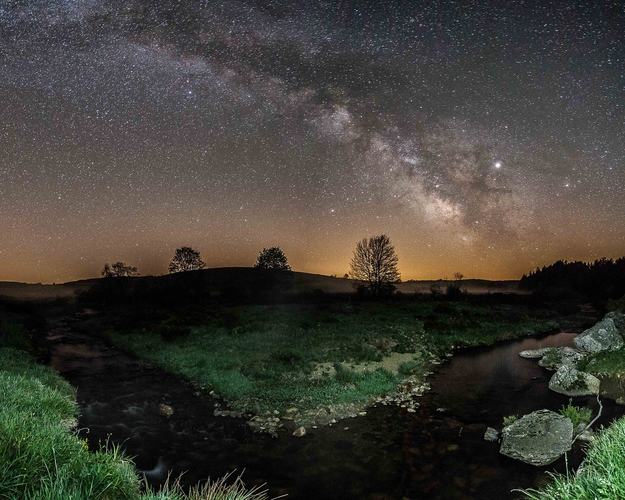 Two rivers meet : the Milky way and a water river by david huguet