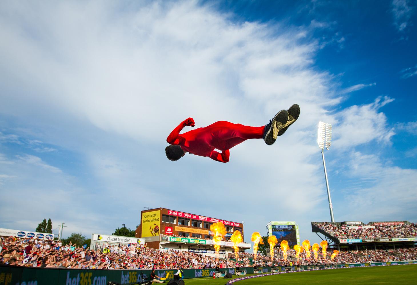 Acrobat mid air by Brad Wendes