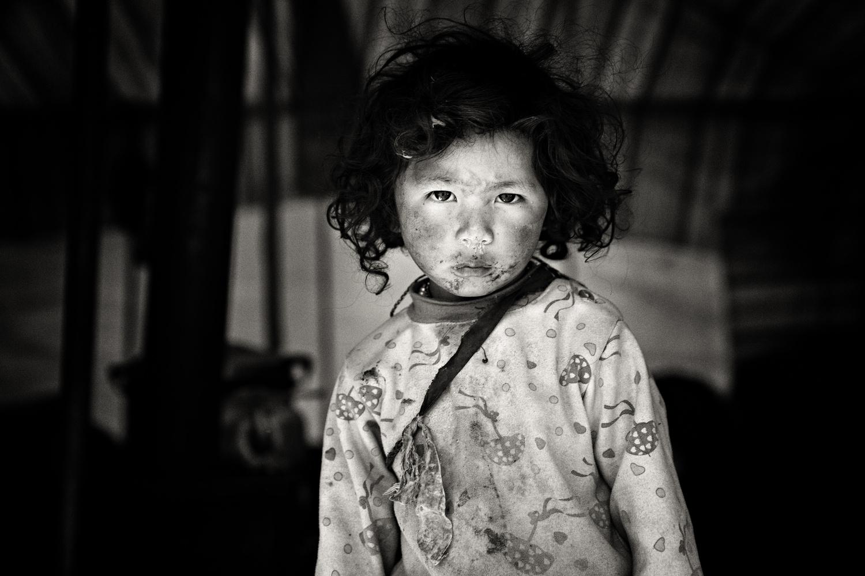 Tibetan Boy by Gil Kreslavsky