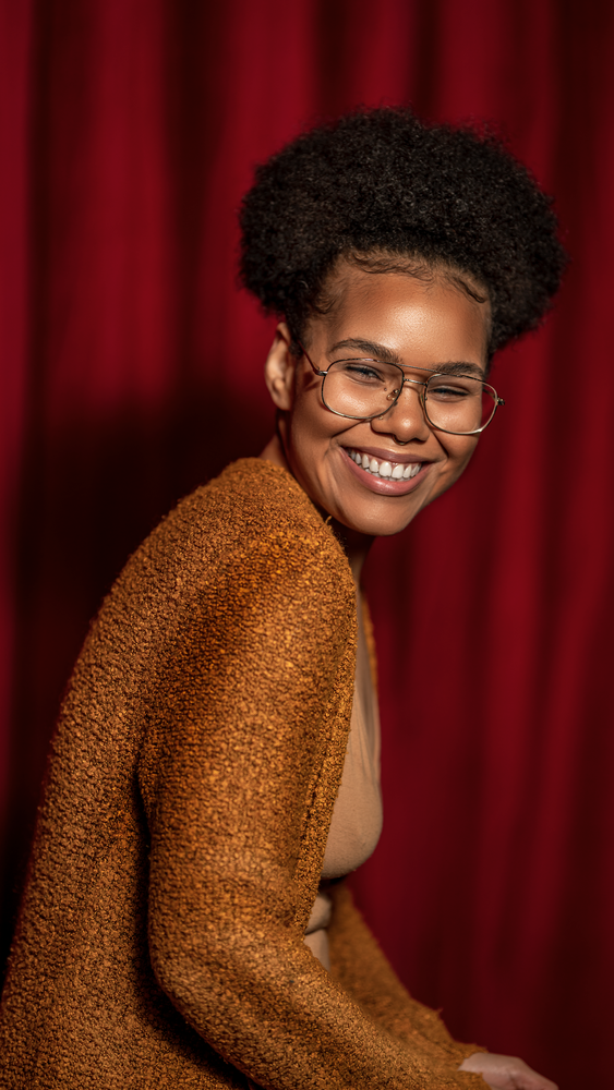 Red Curtain Smile by Dorelle Brock