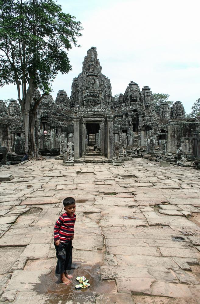 Angkor Watt boy playing by Darryl Villaret