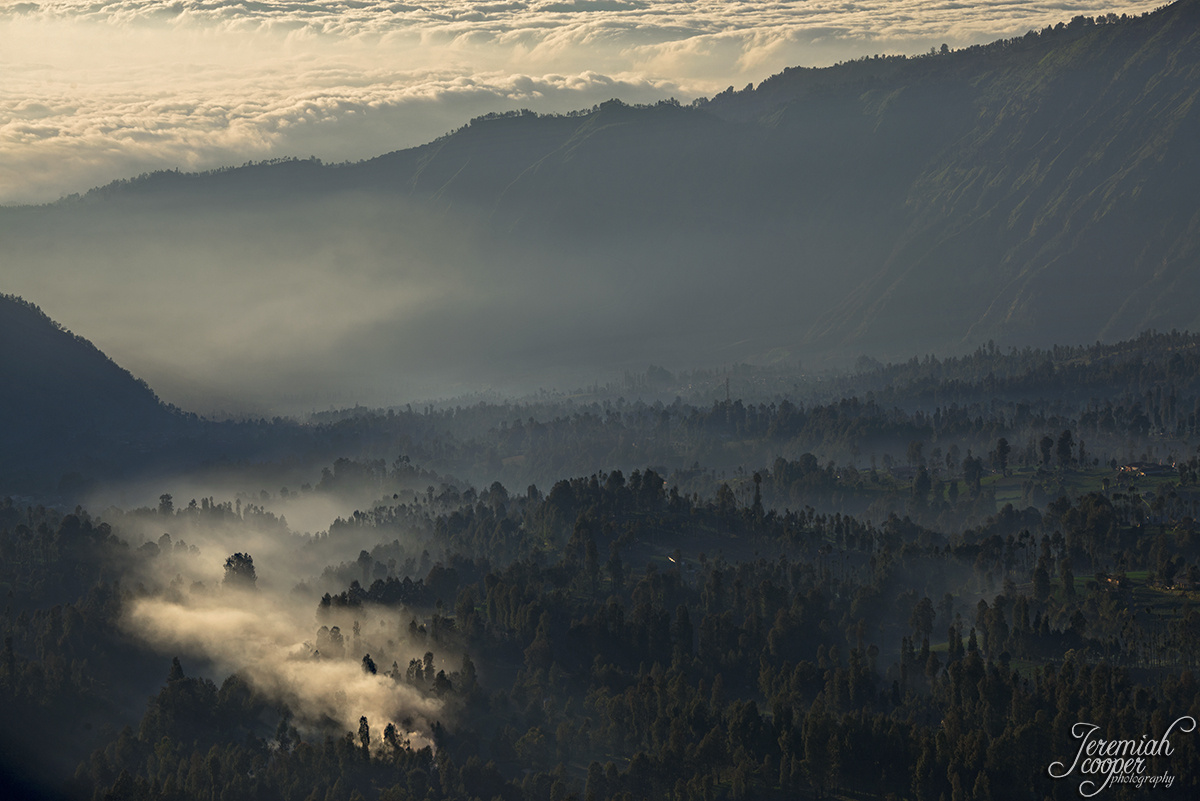Sunrise and smoke over Cemoro Lawang by Jeremiah Cooper