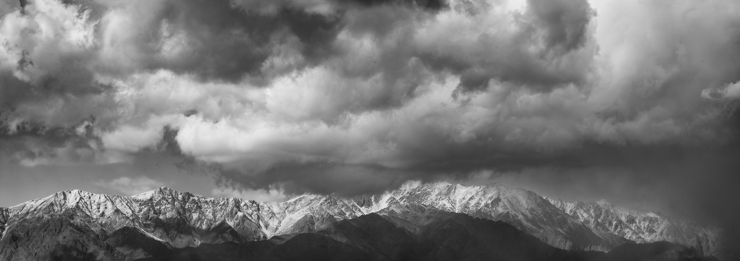 Black and White Mountainscape with Dramatic Clouds by Roger Applegate