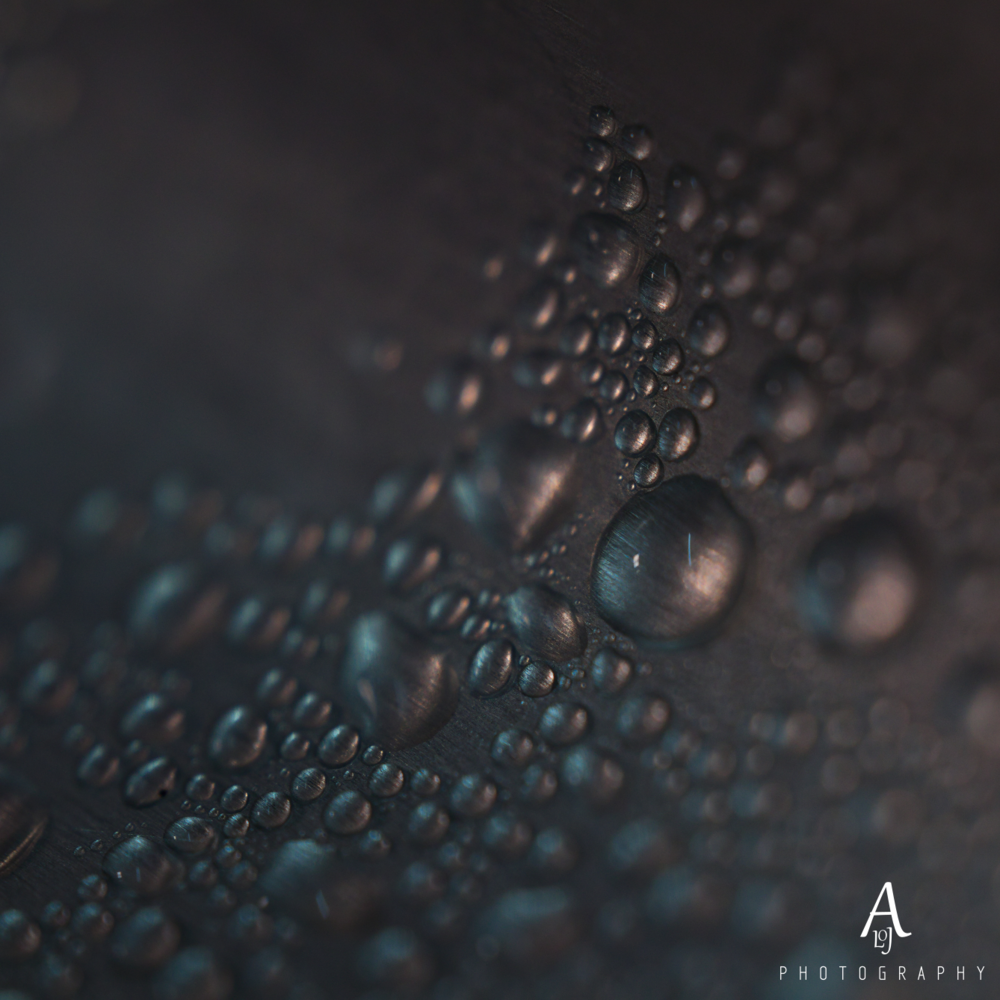 Water on a metallic surface. by Aljo Antony