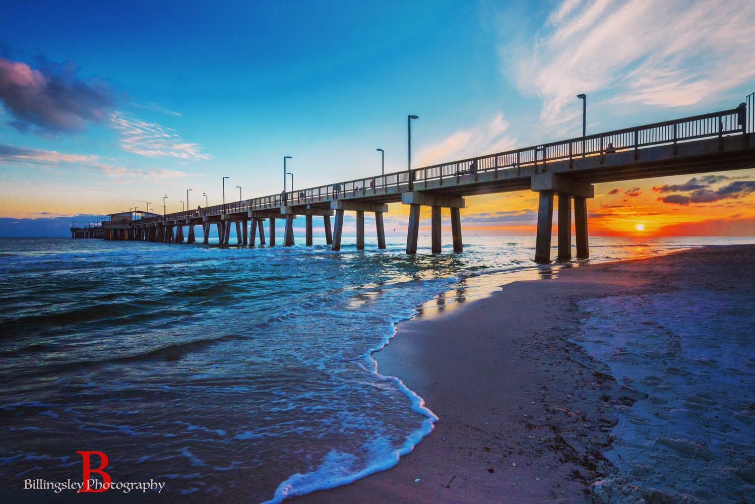 Gulf Shores Pier at Sunset by Cliff Billingsley