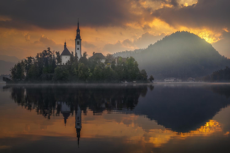 Sunrise in Bled Lake. by Sergio Saavedra