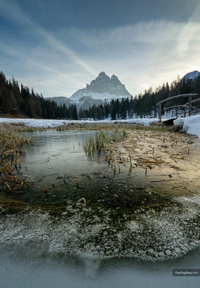Tre Cime and a frozen pond by Maciej Karpinski