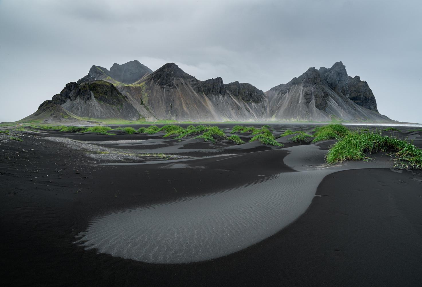 Black beach and mountains by Maciej Karpinski