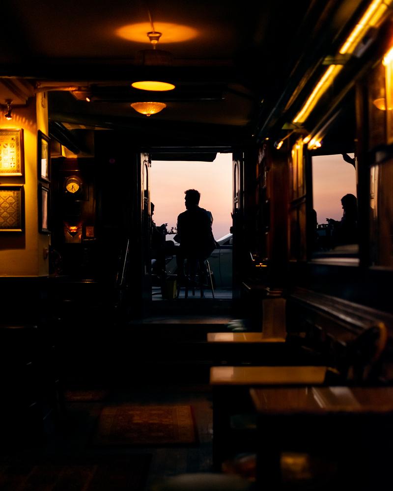 Golden hour in a bar by Panagiotis Tsiverdis