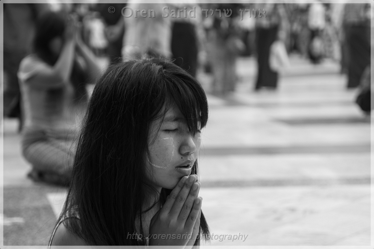 The praying Buddhist girl by Oren Sarid