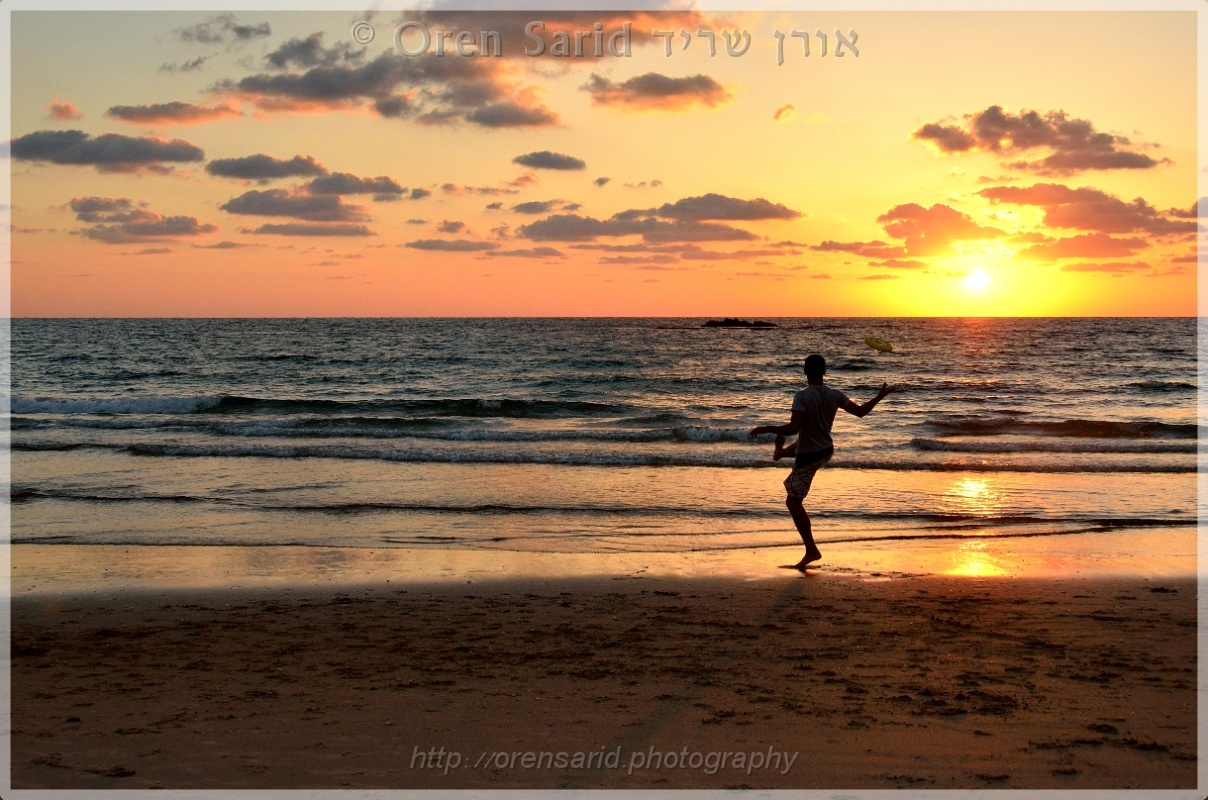 Frisbee player at the beach by Oren Sarid