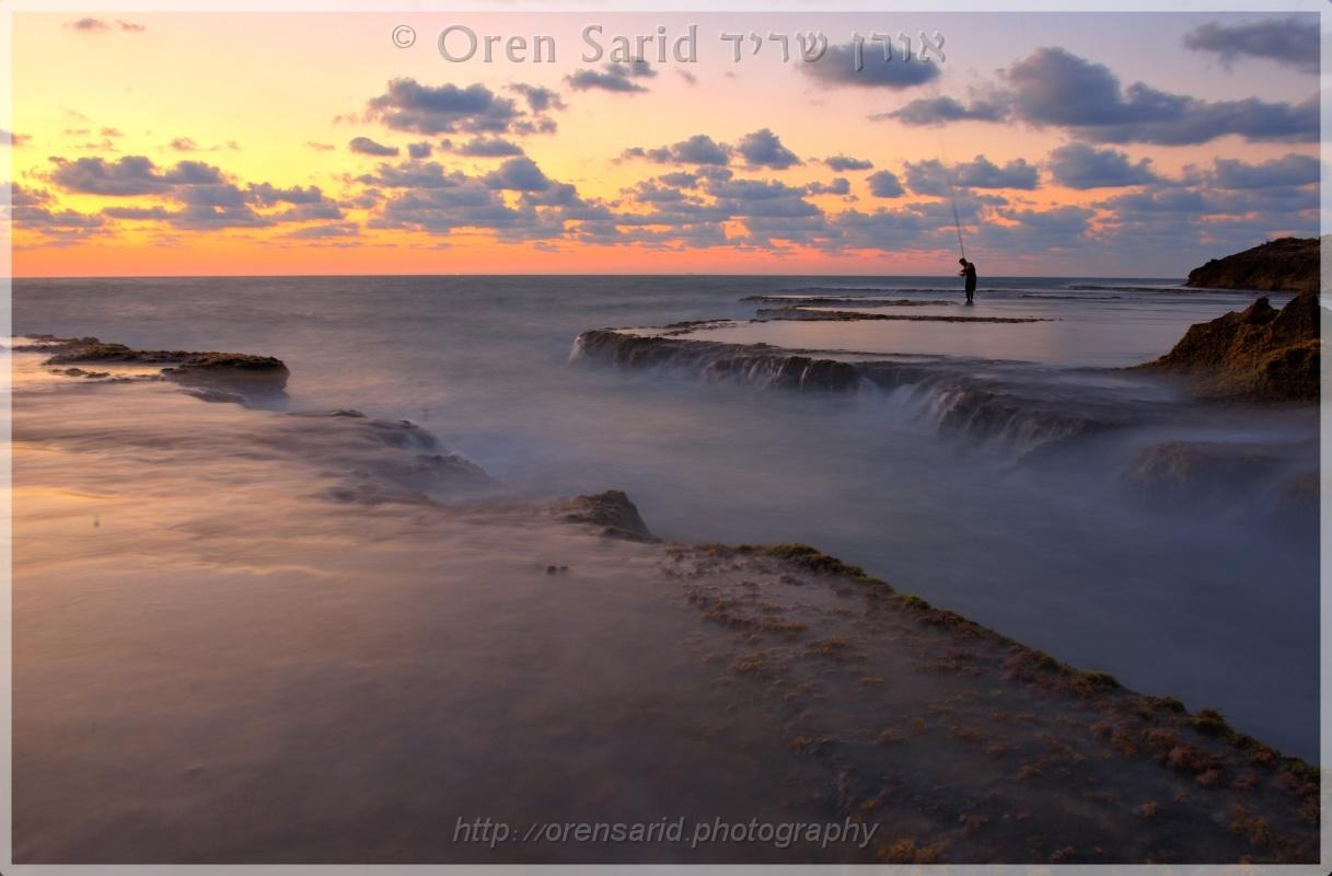 Fisherman at sunset, Atlit, Israel by Oren Sarid