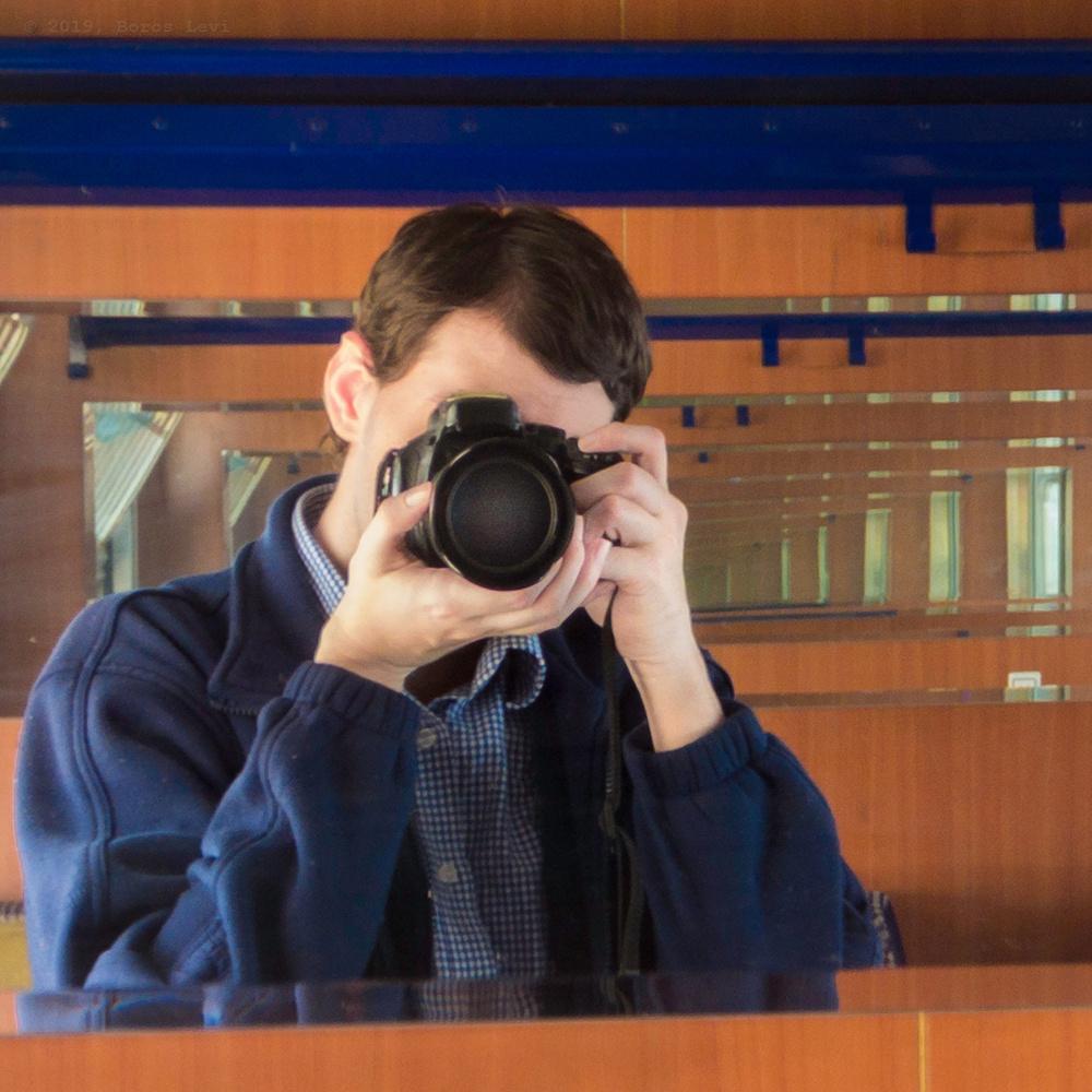Self- portrait  reflections by Levente Boros