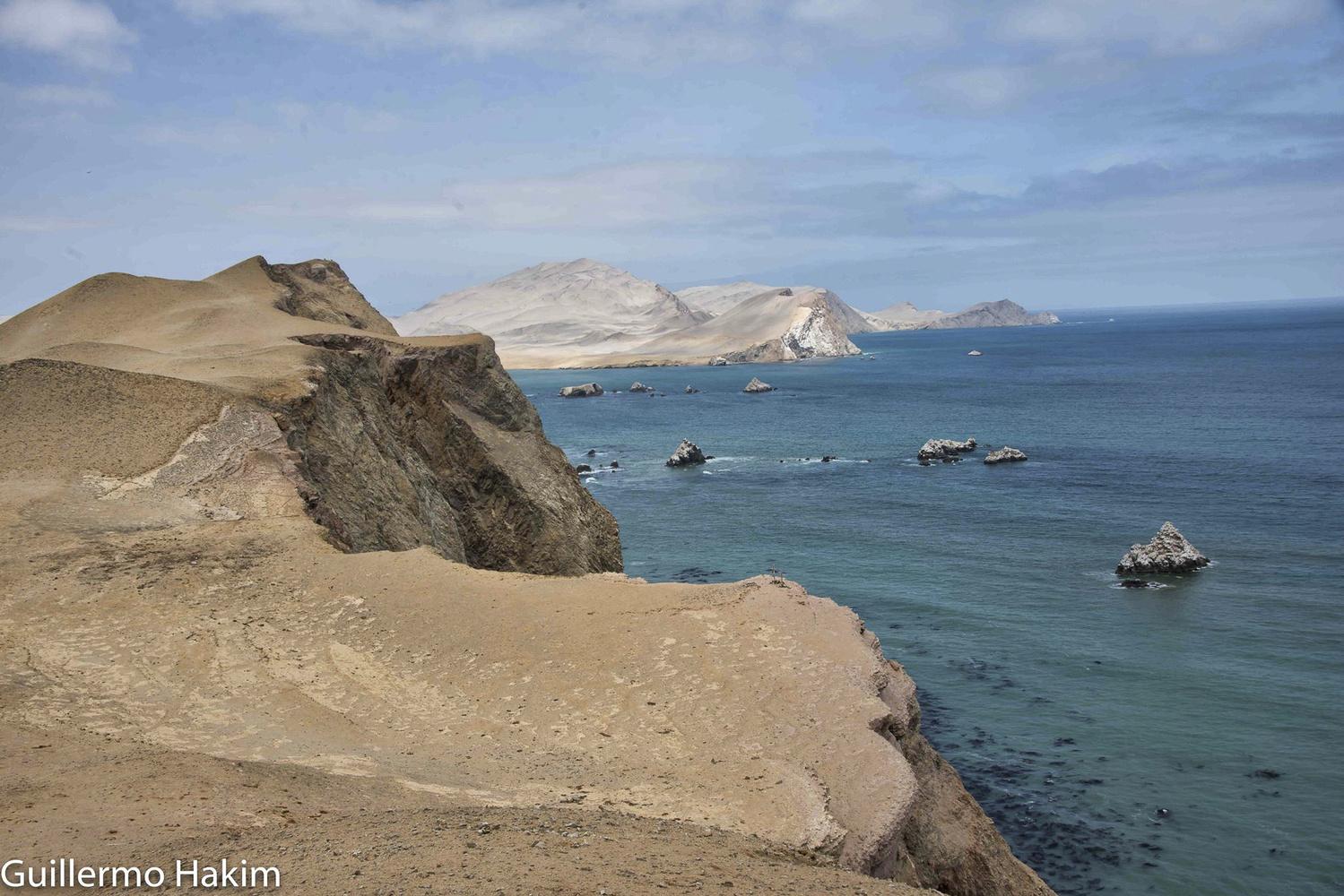 Cliffs meet the ocean by Guillermo Hakim