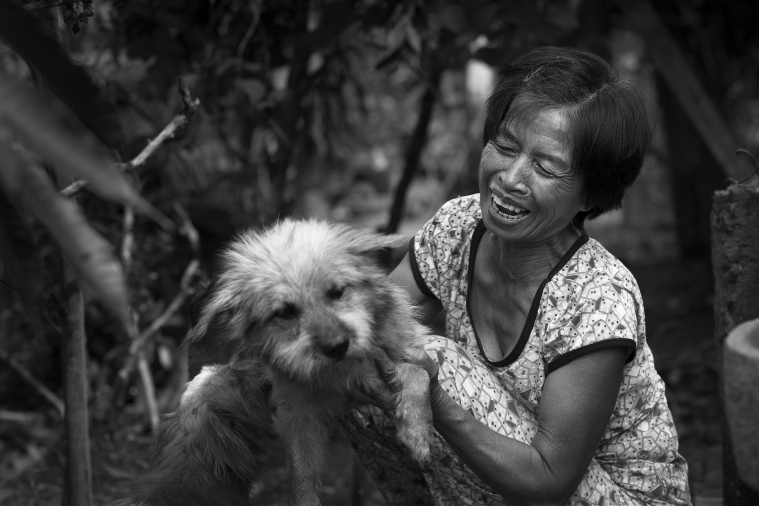 Vietnamese woman with her dog by Léonard Rodriguez
