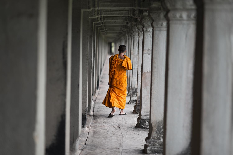 A buddhist monk in Angkor Wat by Léonard Rodriguez