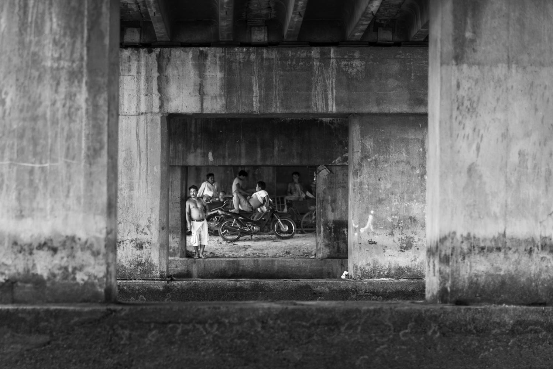 Under a bridge in the Mekong Delta Region by Léonard Rodriguez