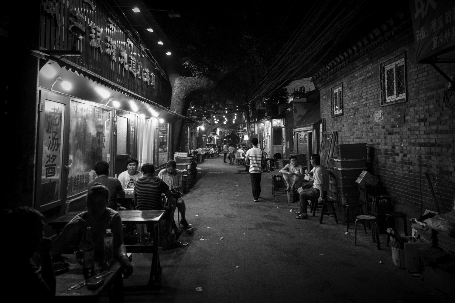 A typical Hutong in DongZhiMen, Beijing by night by Léonard Rodriguez