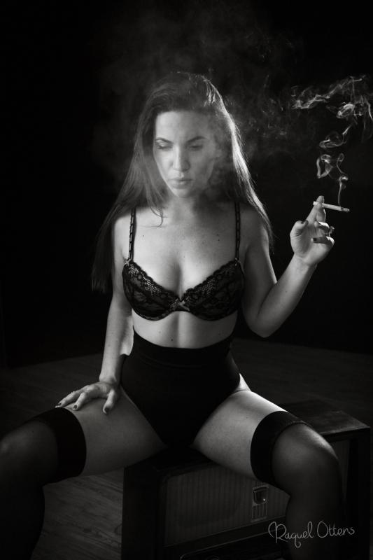 Woman smoking by Raquel Ottens
