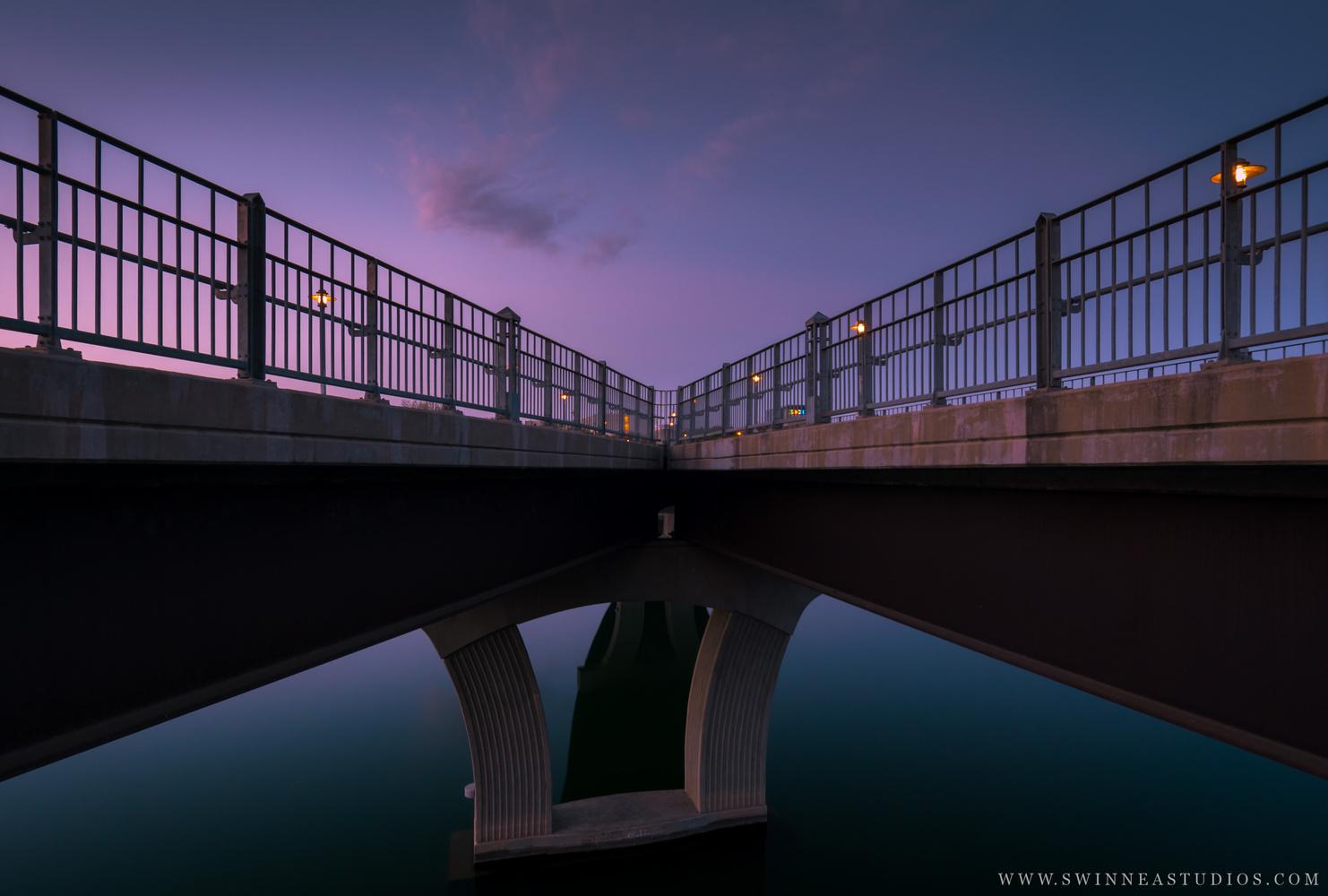 Looking back at the Pfluger Pedestrian bridge at sunrise. by Will Swinnea