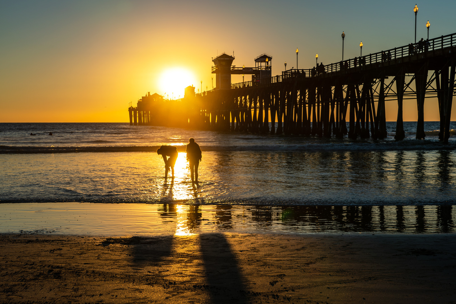 Sunset at the Pier by Teri Dashfield