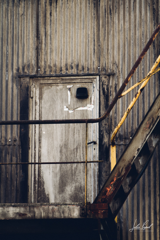 Old Iron Factory Emergency Exit Door by Júlio Papel