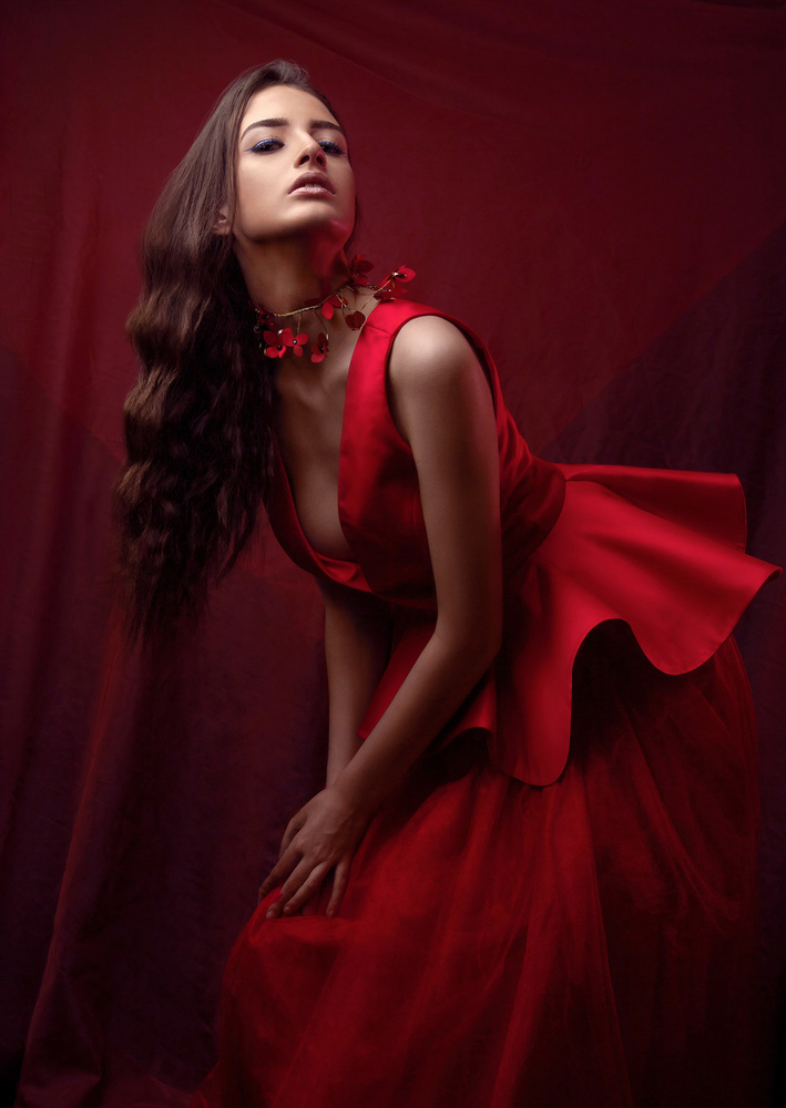 Editorial fashion portrait of Nancy in a red dress by Dilyana Hezhaz