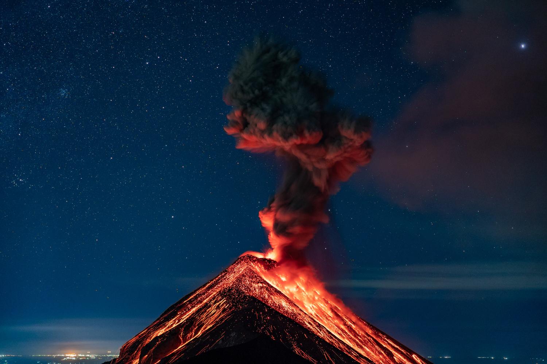 Volcano Erupting underneath the stars by Martijn Hermans