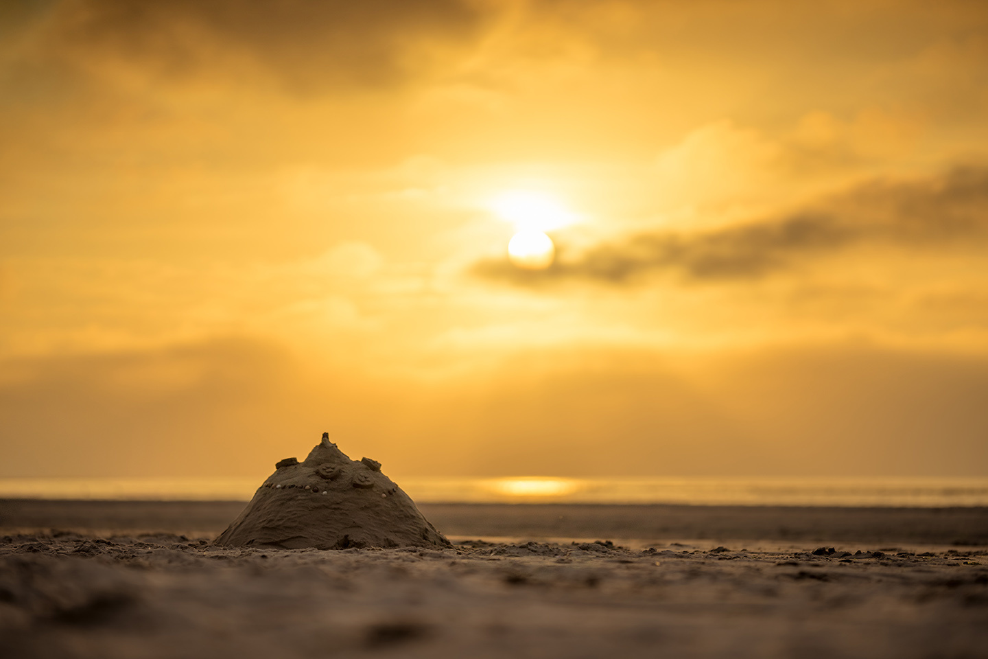 Sandcastle at a beach by Felix Berger