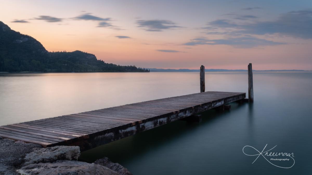 Boat Landing lake Garda Italy by Keith Newman