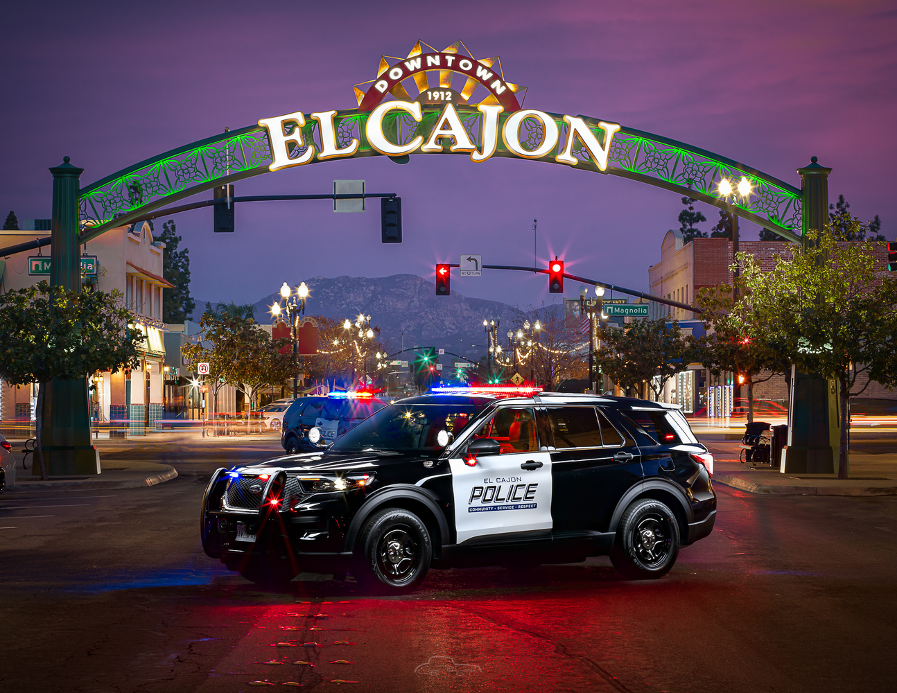 El Cajon Police with El Cajon sign by Creigh McIntyre