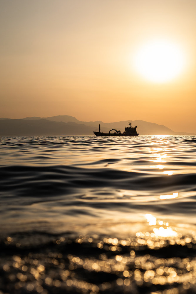Boat off the coast of Loutraki,Greece by Ognjen Petrović