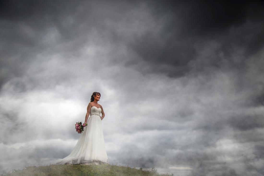 Bride in clouds by Steve Kentish